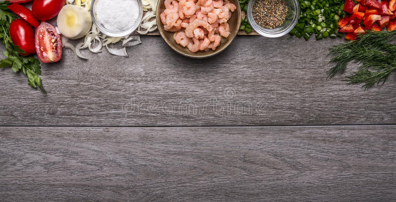 Border with shrimp with spices and vegetables and herbs on wooden background top view Banner for website royalty free stock photos