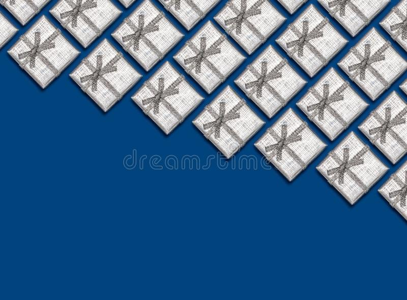 Border of silver shiny gifts on blue background. Christmas decorations. Border of silver shiny gifts on blue background. New Year`s and Christmas decorations stock photo