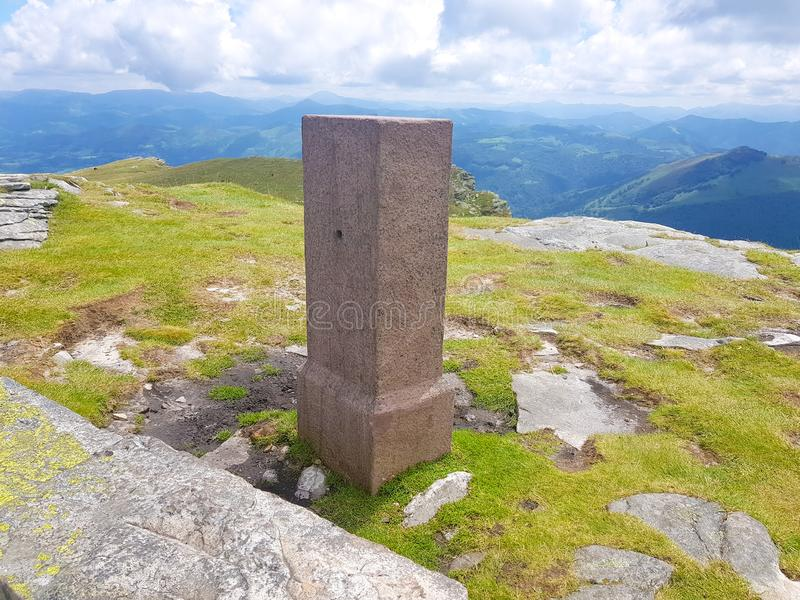 Border stone stone on Mount Larrun. Demarcation between the border of Spain and France in the Pyrenees. Sign emblem europe symbol borderline frontier rhune old stock images