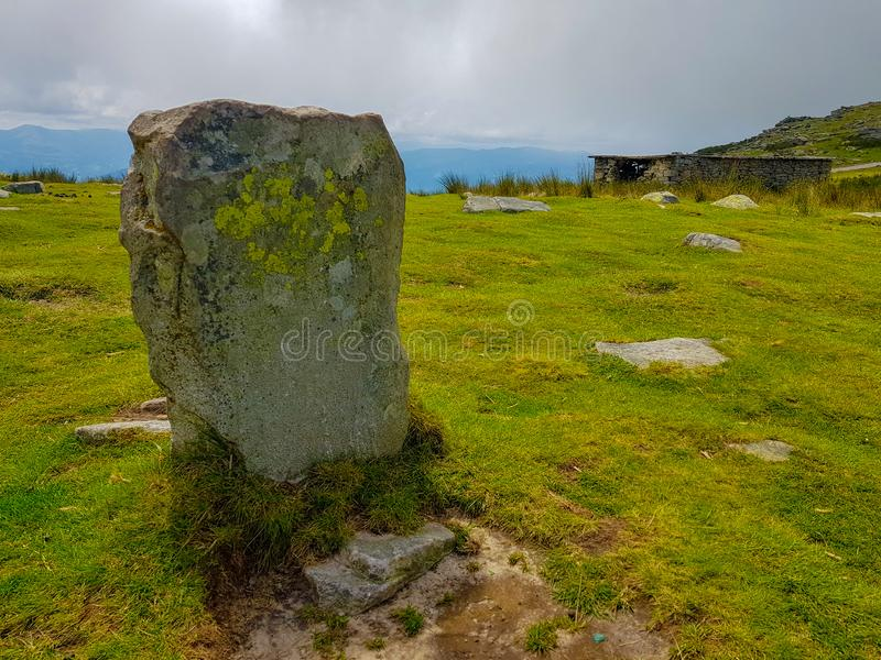 Border stone stone on Mount Larrun. Demarcation between the border of Spain and France in the Pyrenees. Sign emblem europe symbol borderline frontier rhune old stock photo