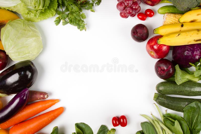 Border various fresh fruits and vegetable on white background. Concept healthy eating and diet or vegetarian food stock images
