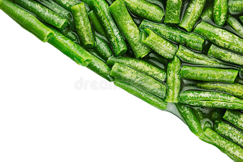 Border of wet fresh green french bean in water closeup on white background. Isolated. Healthy vitamin food royalty free stock photos