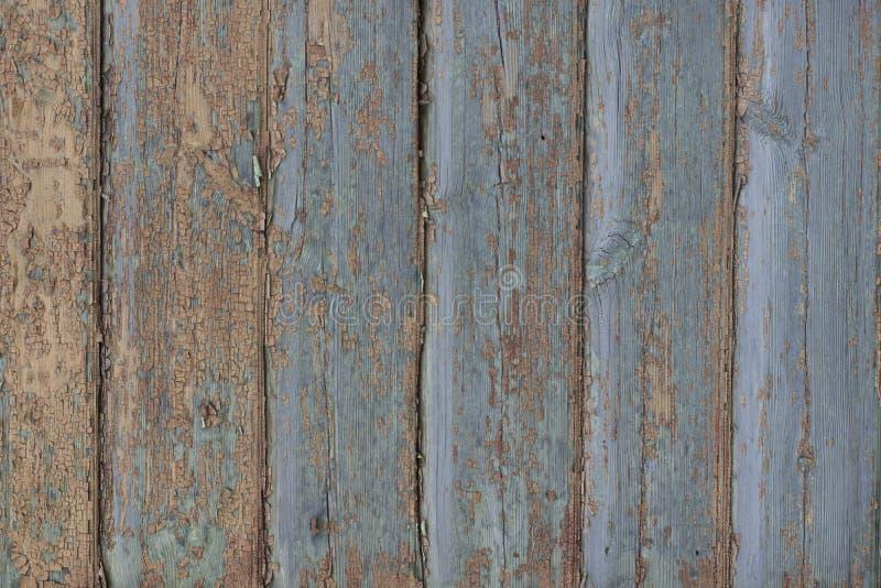 Bordi blu di legno anziani con pittura di sbriciolatura immagine stock