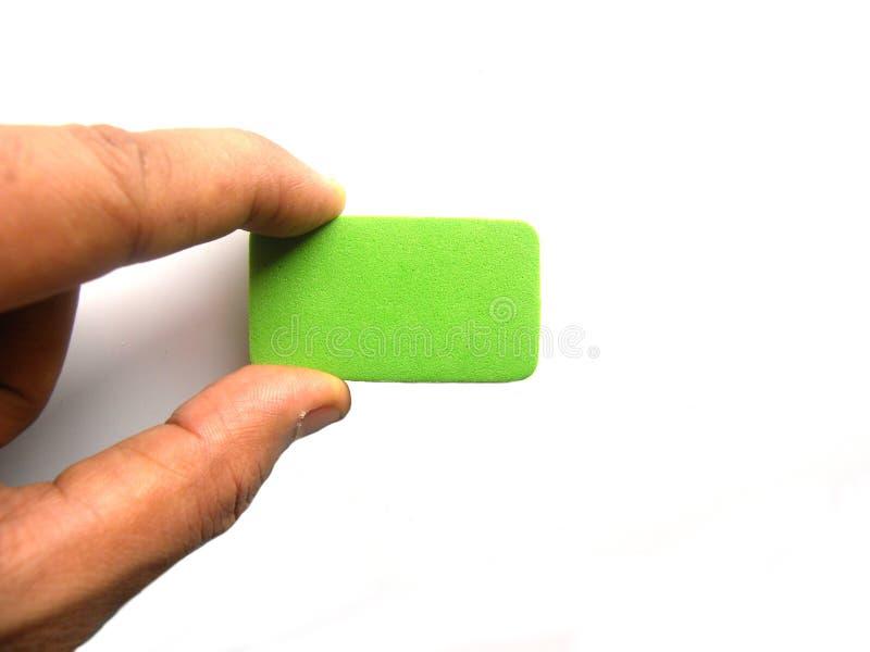 Bordo bianco di pulizia della mano dal piccolo spolveratore fotografia stock