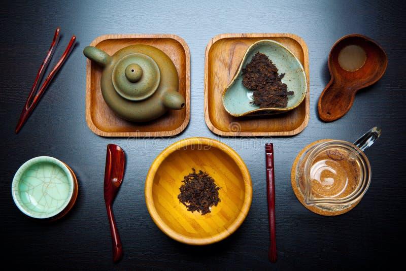 Bordo cinese del cucchiaio della teiera di cerimonia di tè nero fotografie stock