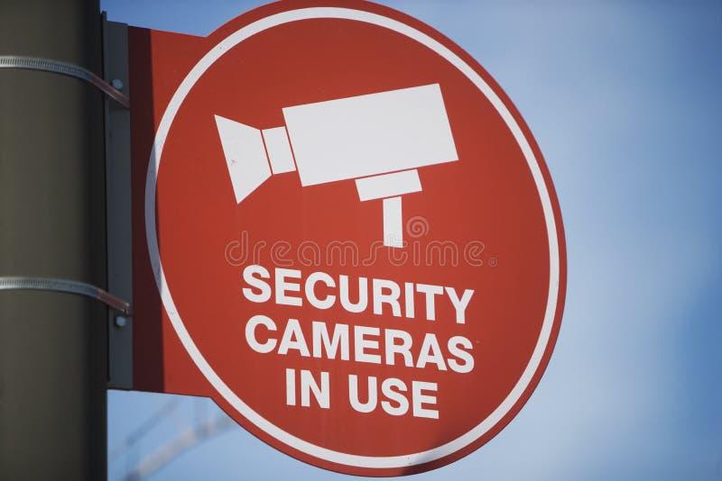 Bordo del segno della videocamera di sicurezza fotografie stock libere da diritti