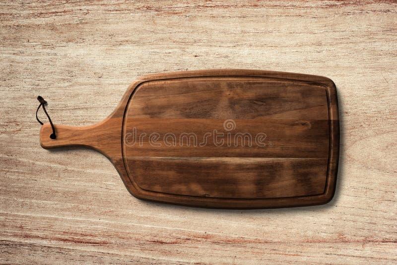 Bordo del servizio del pane sul fondo di legno della tavola immagine stock