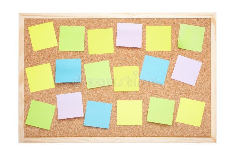 Bordo del sughero con le note in bianco immagine stock
