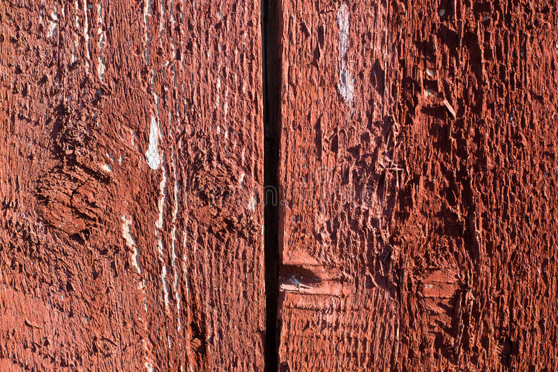 Bordo di legno dipinto rosso incrinato fotografia stock