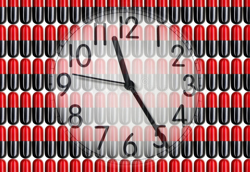 Borduhr auf Pillen lizenzfreie abbildung
