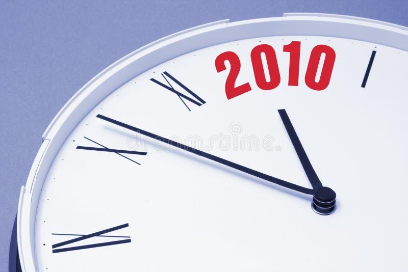Borduhr-Gesicht und 2010 lizenzfreies stockbild