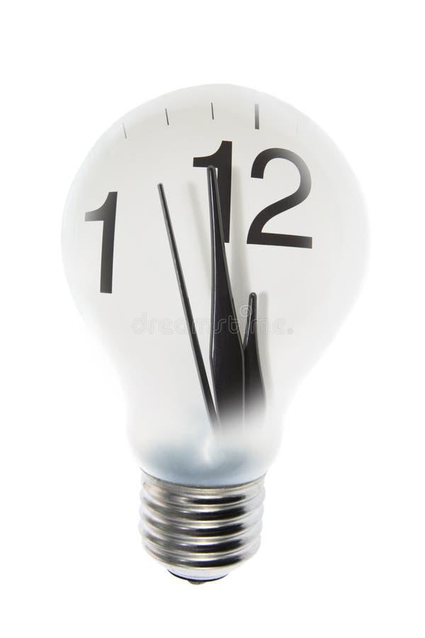 Borduhr und Glühlampe lizenzfreies stockbild