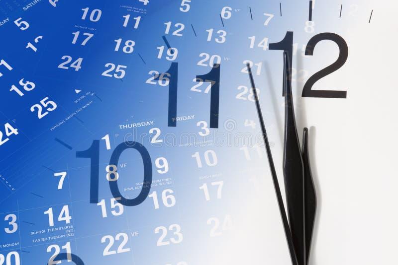 Borduhr-und Kalender-Seiten stockfotografie
