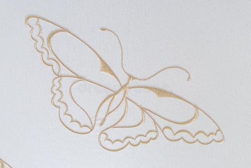 Borduurwerkvlinder op katoen stock fotografie