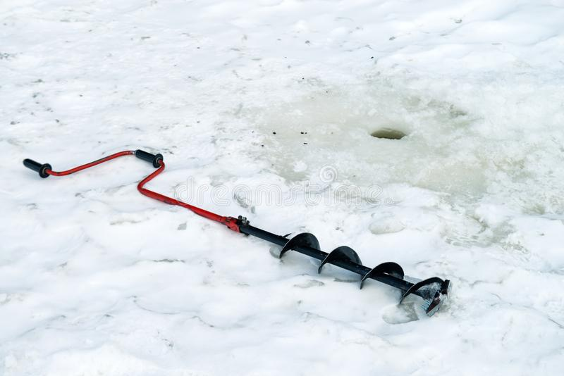 Bore hole for winter fishing stock photo
