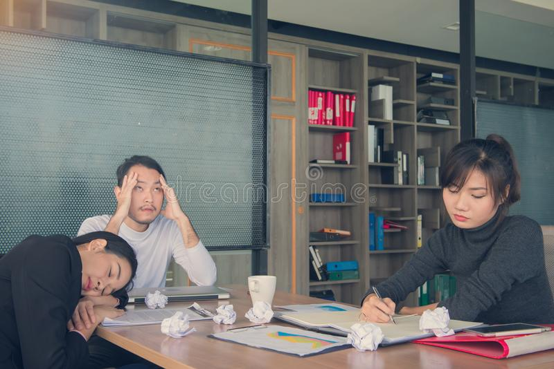 Bored business people and sleeping resting on workplace during w royalty free stock photo