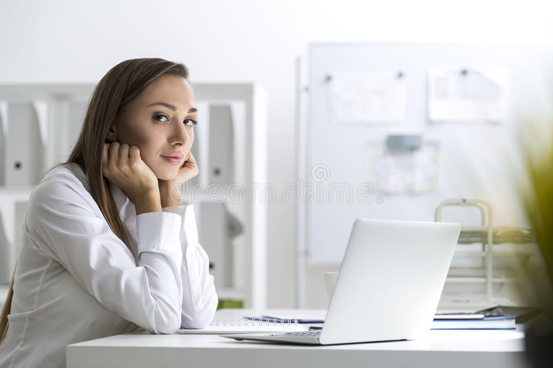 Download Bored Businesswoman At Her Workplace Stock Photo - Image: 83722726