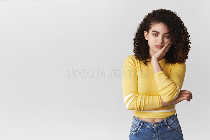 Bored careless indifferent young moody girl have no interest family event standing reluctant annoyed facepalming lean. Face hand look camera ignorant, standing stock photo