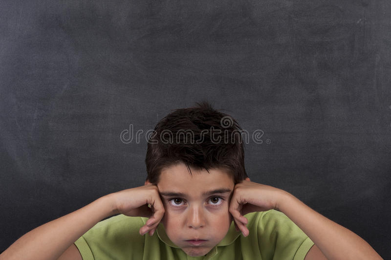 Bored child at school royalty free stock photo