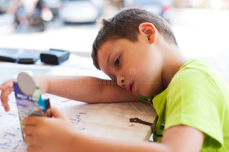 Bored child waiting for meal stock image