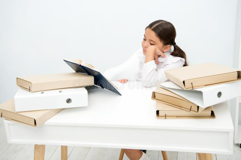Bored concept. Cute girl got bored with much information. Little child feel bored and dull doing homework. I am bored royalty free stock images