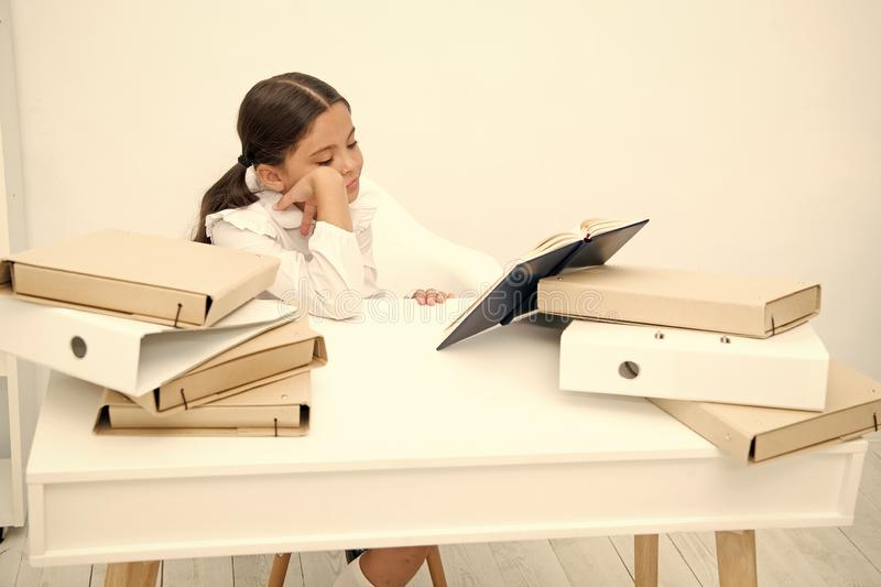 Bored concept. Cute girl got bored with much information. Little child feel bored and dull doing homework. I am bored stock photo