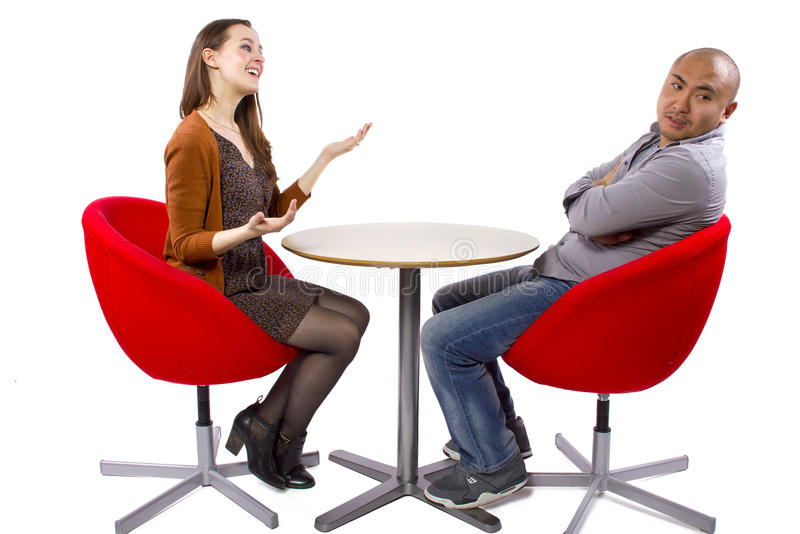 Bored Date. Interracial date that is boring and un-romantic stock photos