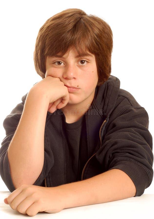 Bored jonge tienerjongen stock foto's