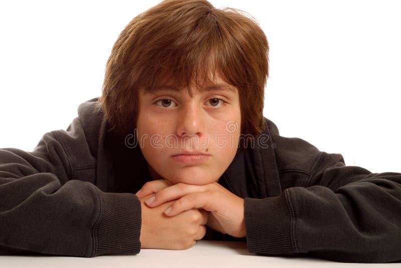 Bored jonge tienerjongen royalty-vrije stock afbeeldingen