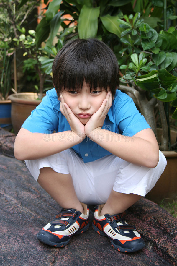 Bored jongen stock foto