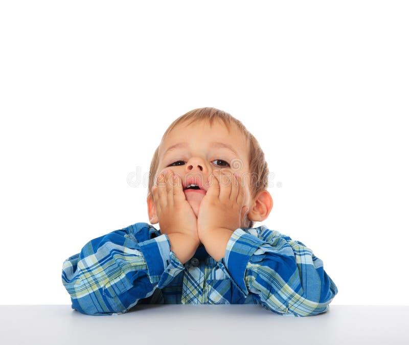 Bored little boy stock image