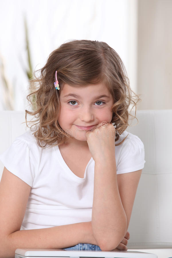 Bored little girl. Grumpy little girl looks bored stock photos