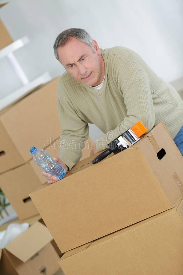 Bored man preparing to move out stock image