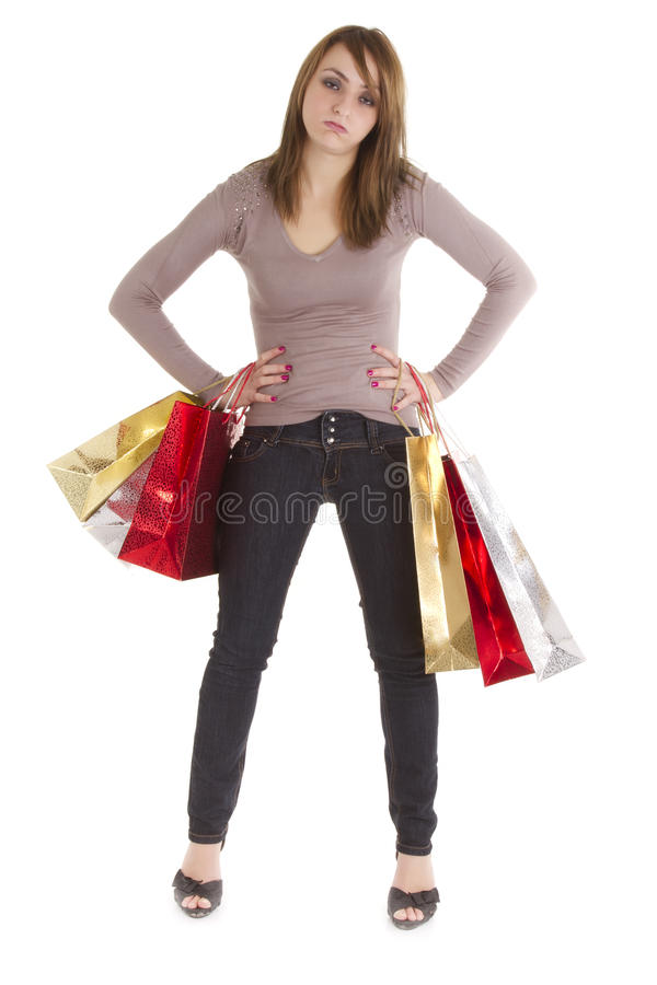 Bored shopper woman. With bags isolated on white stock photography