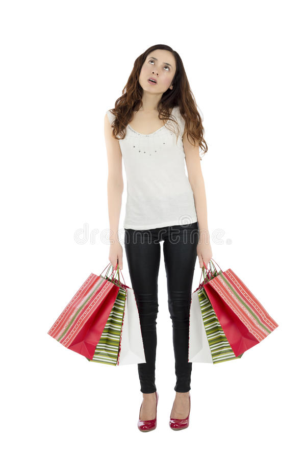 Bored shopping woman carrying paper bags royalty free stock photography