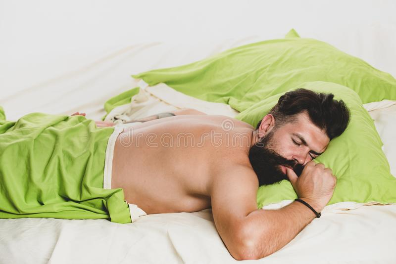 Bored sleepless and tired in bed. Man sleep in bed alone. Happy to Sleep. Sleep disorders concept. Guy lying in bed try. To relax and fall sleep stock image