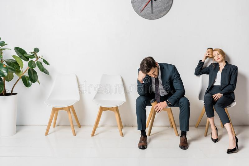 bored tired business people waiting on chairs royalty free stock photos