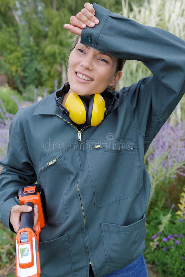 Bored and tired female gardener royalty free stock photo