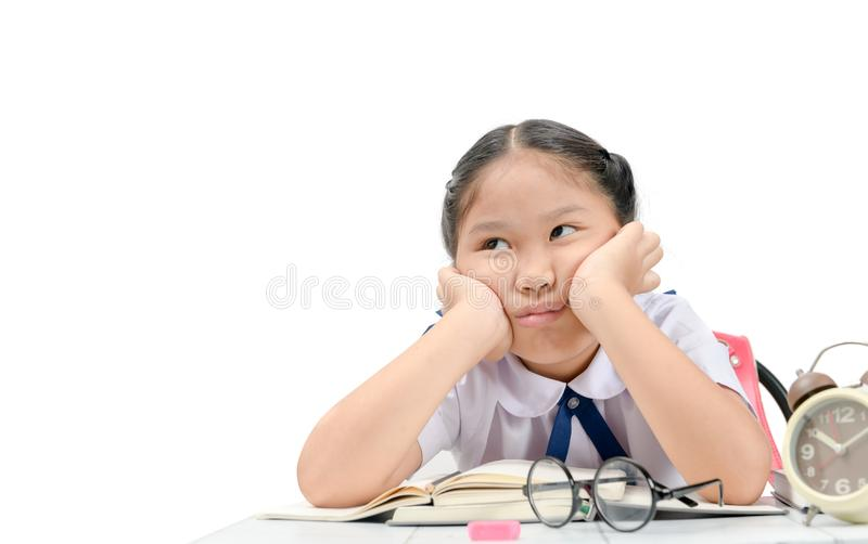Bored and tired girl doing homework royalty free stock photos
