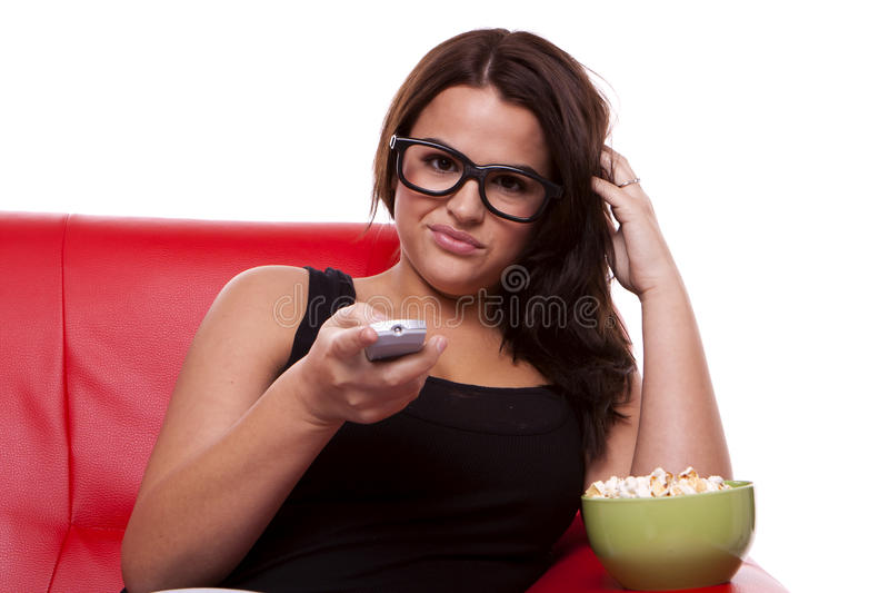 Bored vrouw die op TV let. royalty-vrije stock fotografie