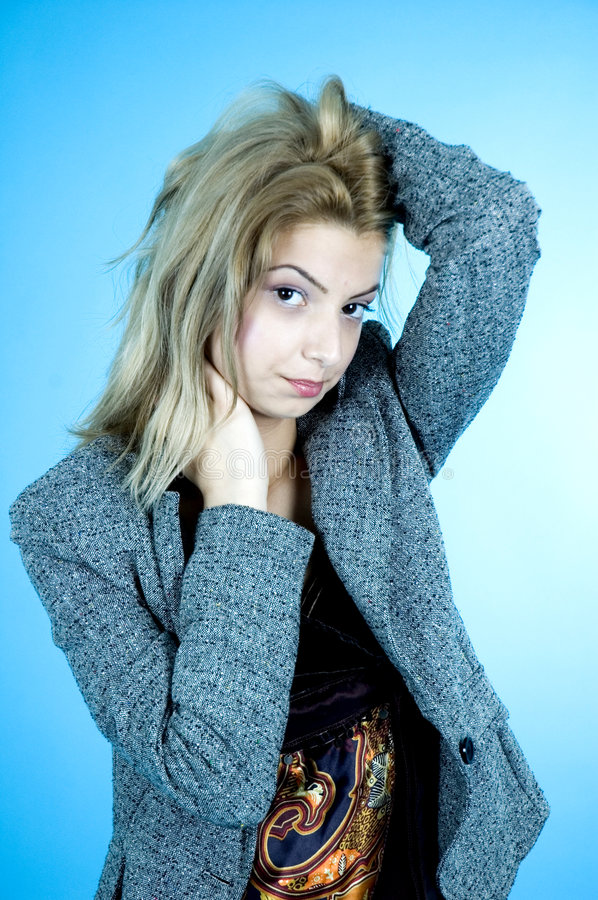 Bored Woman. Young woman with one hand on her head and the other against her neck, with a bored expression stock photo