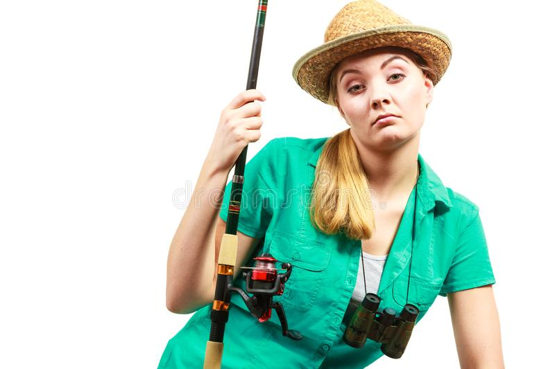 Bored woman with fishing rod, spinning equipment stock photos