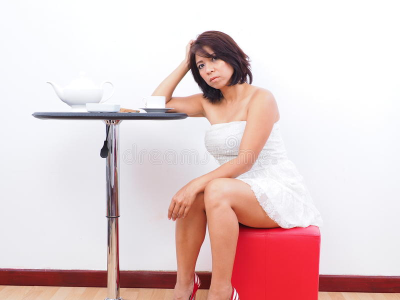 Bored woman at home stock photo. Image of asian, dress - 61463114