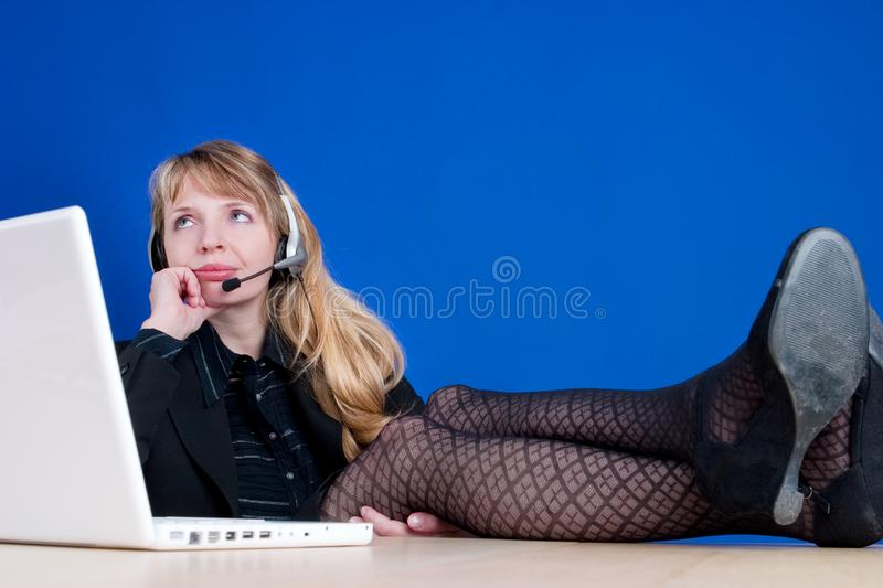 A bored woman on the telephone stock photo