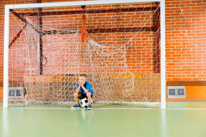 Bored Young Boy Waiting On An Indoor Soccer Court Stock Image ...