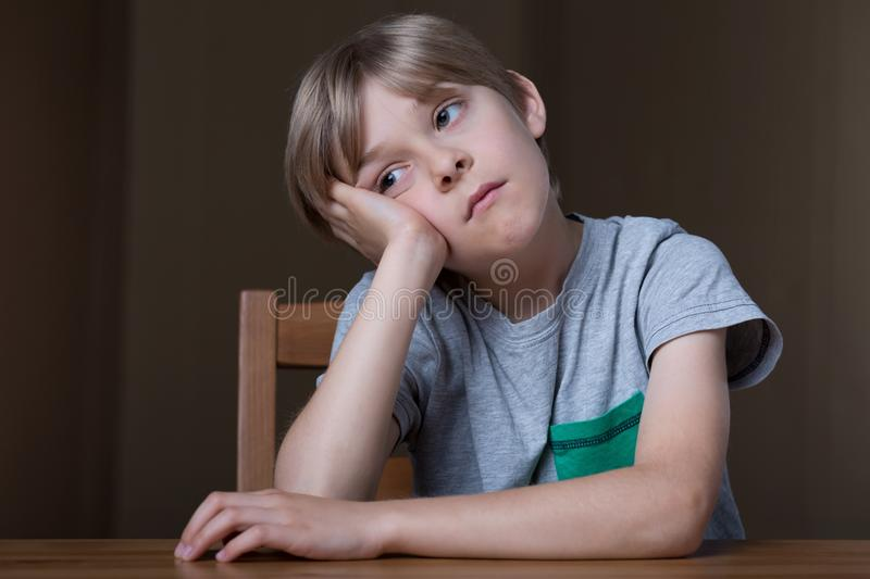 Bored young kid stock image