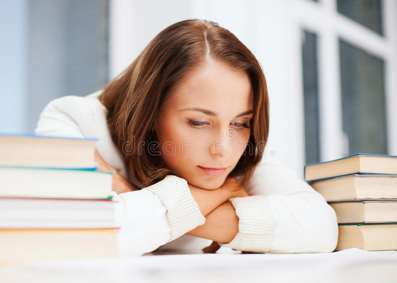 Download Bored Young Woman With Many Books Indoors Stock Images - Image: 33878144