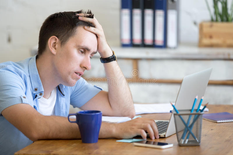 Bored young worker man stock photo