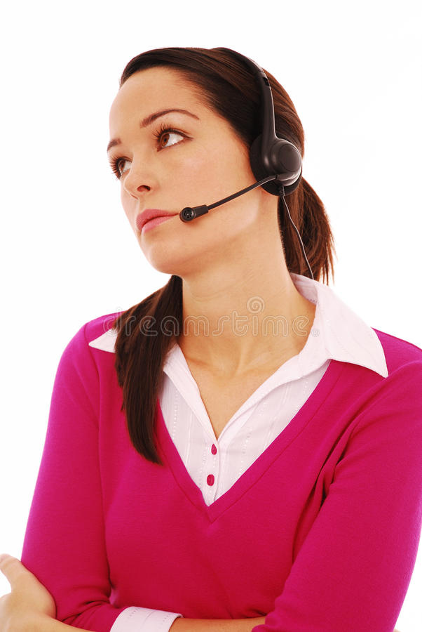Boredom at work. Bored woman wearing headset isolated on white stock photography