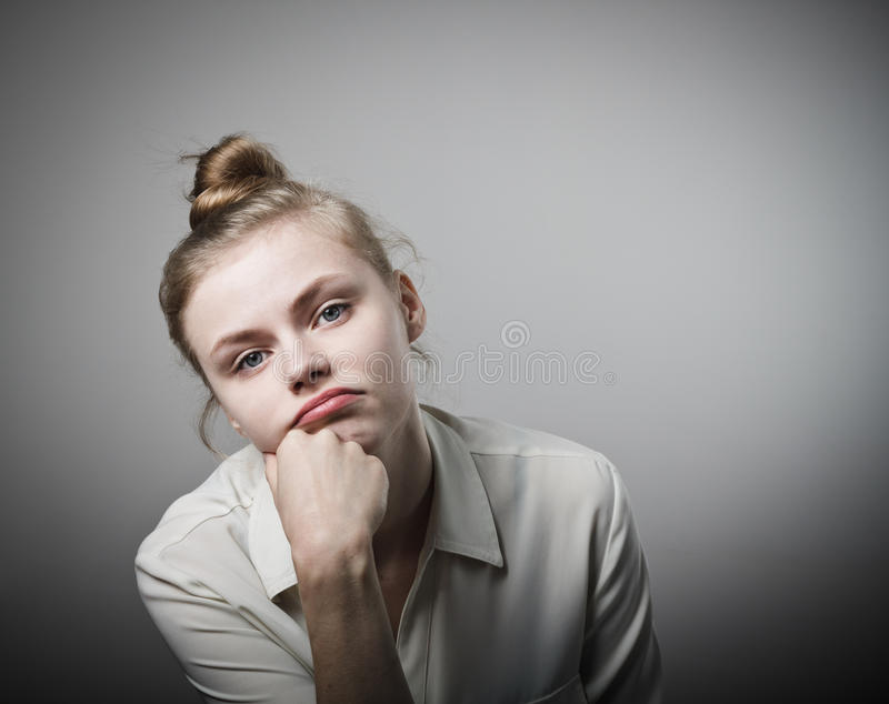 Boredom. Young slim woman being bored of doing nothing stock images